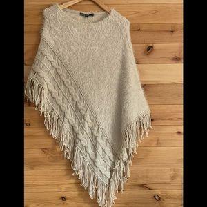 LoveStich fuzzy crochet poncho with fringe in tan